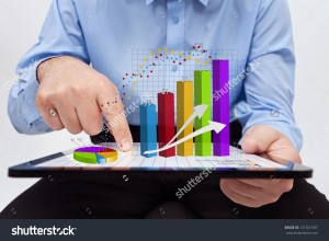 stock-photo-businessman-editing-the-annual-report-charts-working-on-a-tablet-computer-131501597